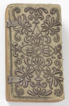 """""""The Holy Bible"""" covered with green silk satin and embroidered in a symmetrical vine pattern using metallic yarns. The embroidery is very high relief."""