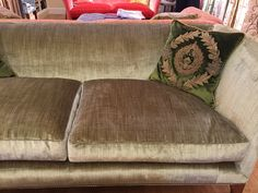 warwick sofa from Beaumont and Fletcher in Como silk velvet colour Moss with bronze studs and piped on cushion edges.