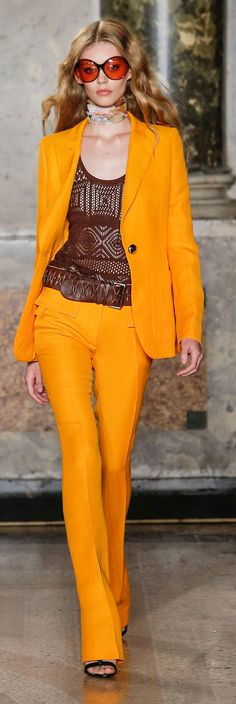 Emilio Pucci...Exciting Bright Yellow...with brown top goes so well together topped off with dramatic sunglasses....What a fabulous look!...