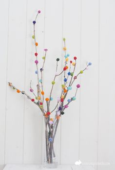 cheerful pom poms on branches