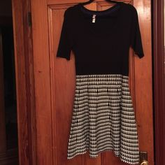 Soft sweater dress 💕 Transition to cool weather easily with this soft sweater dress. Large houndstooth print on the skirt and top is solid black. Very comfy slightly thicker sweater material. Never worn! Xhilaration Dresses