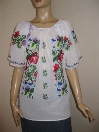 Charming handmade Romanian peasant  blouse, hand embroidered with multicolored cotton and acrylic thread on a thicker gauze cotton in order to not be so sheer.  Available at www.greatblouses.com