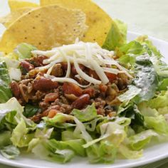 Lower-Calorie Tex-Mex Taco Salad -- A super-quick blend of reduced-fat sour cream and salsa serves double duty as salad dressing and seasoning for the meat in our updated version of Tex-Mex taco salad. We keep this version light with lean turkey, but lean ground beef (about 95%-lean) would also keep the nutrition marks reasonable.