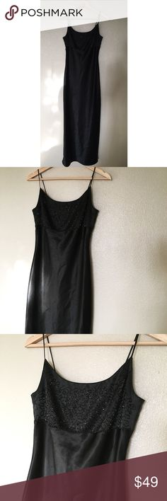 Black Silky Floor Length Spaghetti Strap Gown Stunning Black Silky Floor Length Spaghetti Strap Gown - Beaded detail on chest area. Says Size 6, but feels a lot smaller. Zipper in back. Measurement details to come later. In excellent condition. Figure flattering.  **Listed as Cache for visibility only.** Dress is from a Vietnamese boutique. Thanks for looking! Cache Dresses