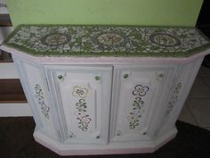 vintage cabinet that I painted, stenciled and mosaic