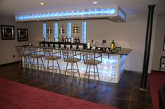 Glass block bar with lighting. Tile work also done by Jackson Masonry has the look of burnt metal.
