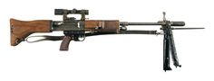 """This is an example of an extremely rare late World War II Fallschirmajagergewehr FG42 paratrooper rifle, with the original Luftwaffe ZF4 sniper scope and mount. It is estimated that only approximately 5,000 were ever manufactured, of which few survived. This example is a mid-production Second Model that has the more horizontal grip with bakelite panels, laminated buttstock, and two-piece wooden fore-end. The receiver is marked: """"fzs/FG42/02314"""", where fzs was the wartime code for Krieghoff."""