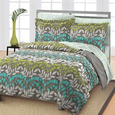 "Loft Style Leaves Bedding Comforter Set $60 Material content: 60 percent cotton/40 percent polyester. Fill content: 5 oz, 100 percent polyester. Twin set includes: comforter (66"" x 86""), standard sham (20"" x 26""), flat sheet (66"" x 96""), fitted sheet (39"" x 76"" with a 10"" pocket) and pillowcase (20"" x 30"")"