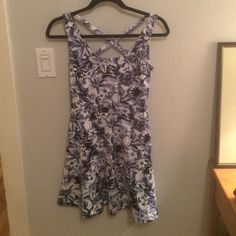 """H&M Cross Back Dress in Blue Floral Print Great condition. Labeled as a size XS but fits much more like a S. Has been hemmed a bit (only a little more than an inch) so it would fit more mid-thigh on me. I am 5'5"""" FYI. Great for the spring and summer. Super comfy dress in a stretchy material. H&M Dresses"""