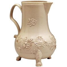 A fine antique early English pottery water jug in saltglaze stoneware.  The jug is very finely potted and is decorated with applied trailing leaves,stems and flowers. It is a classic piece from the mid 18th century , the early pioneering days of the Staffordshire potteries. – England, circa 1750 - John Howard, Woodstock, UK