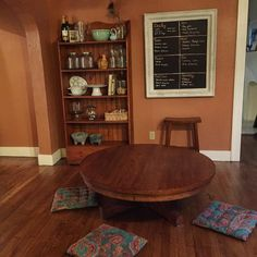 Welcome to our quaint little dining room. We've been floor-sitters for over a year now and I've enjoyed it so far. Nearing 6 months pregnant, getting up and down off the floor several times daily has been beneficial to my daily movement and mobility without having to set aside specific time in a gym to do squats (which I have NO time for right now). This table is actually a large coffee table and I found it through a Facebook local buy/sell page when we lived in Washington. You can also… Floor Desk, Dinning Table, Dining Room, Floor Sitting, Large Coffee Tables, Hearth And Home, Kitchen Remodel, Room Decor, Houses