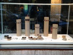 sunglass #merchandising using cardboard tubes and hardware. Window Display Sunglasses - Bågar & Glas Stockholm