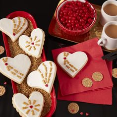 Treat someone special with these cute Cupid's Arrow Valentine Cookies. The decorative hearts and arrows rest on a bed of buttercream icing.