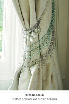 vintage necklaces as curtain tie backs - http://bluevelvetchair.blogspot.com