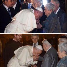 Pope Francis kisses the hands of Holocaust survivors at Yad Vashem
