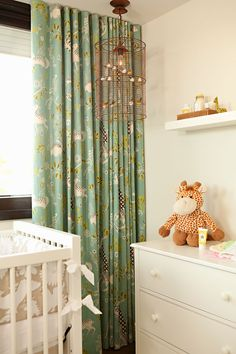 Pretty pattern on simple drapes in a babies room.  Shades filter the light.Projects | Chris Barrett Design