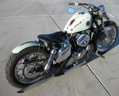 Photo of Harley Bobber Motorcycle in Seafoam Green by Justin of DP Customs.