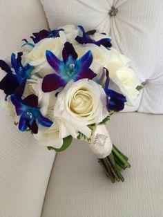 Turquoise and purple floral bouquet ideas - orchids and roses #turquoise #turquoisewedding #wedding #flowers #bouquet