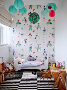 fun wallpaper and colorful paper lanterns + Ikea rug #toddlerrooms #kidsdecor
