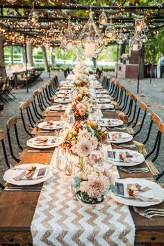 Industrial style wedding tables and lighting Photo: Elle Jae Photography