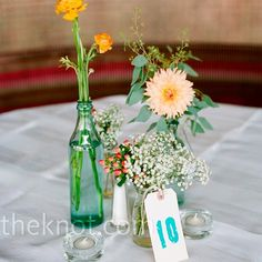 Simple Floral Centerpieces // so many little containers would be a pain to clean up after the party's over. :P