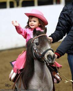 Little cowgirl in pink on her trusty little cute pony.