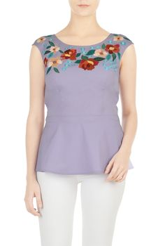 Floral embellishment around the scoop neck tops our peplum blouse in light stretch cotton poplin.