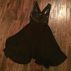 Forever 21 Sequin Cocktail Dress All black, vertical sequins, a lot of fabric for the skirt, gathers at waist and flairs out, adjusted to be flared in the picture, clear hanger straps don't show when wearing, to the knee or above the knee, worn twice, looks brand new, make an offer! Forever 21 Dresses