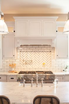 Glazed brick backsplash with herringbone pattern pot filler niche - by Rafterhouse.