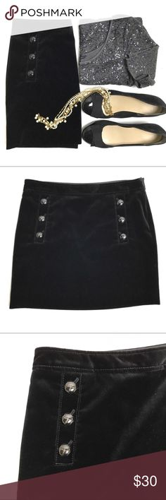 Banana Republic Black Velvet Mini Skirt NWOT Beautiful NWOT black velvet mini skirt from Banana Republic. Decorative buttons detail the front, giving it a preppy look. Super soft velvet is in perfect condition. Great skirt paired with a sparkly top and heels for a party or wear it with a blazer and flats for work. Fully lined. 100% cotton velvet/100% acetate lining. Dry clean. Banana Republic Skirts Mini
