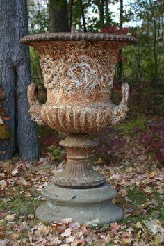 iron garden urns- feature for circular garden