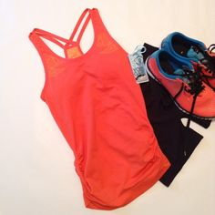 """ClimaWear yoga tank It's orange w/ tangerine color detailing. Seamless, cinched on the sides. Built in bra w/ removable pads. So soft and stretchy. 25"""" length, 13-15"""" bust. trades.  ClimaWear Tops Tank Tops"""