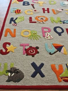 alphabet rug with adorable characters for each letter! alphabet rug with adorable characters for each letter! Toy Rooms, Kid Spaces, Kids Rugs, Kids Playroom Rugs, Playroom Ideas, Garage Playroom, Playroom Design, Nursery Ideas, In Kindergarten