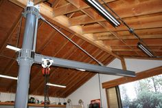 Rotating I-Beam Jib Crane - Homemade overhead crane fashioned from a trolley and hoist hung on an I-beam. Custom-made collars for an existing garage post were cut on a plasma table. The crane is rated at approximately 1 ton. Garage Tools, Garage Shop, Diy Garage, Garage Workshop, Woodshop Tools, Metal Projects, Welding Projects, Woodworking Power Tools, Woodworking Shop