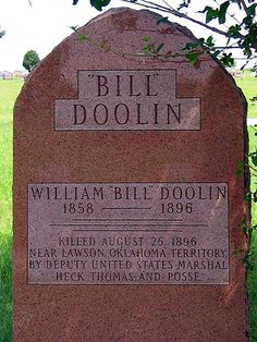 """Grave of Bill Doolin    Grave of bank robber Bill Doolin, founder of the Wild Bunch (also know as the Doolin-Dalton Gang). Seen in Summit View Cemetery in Guthrie, Oklahoma.    """"Killed August 25, 1896 near Lawson, Oklahoma Territory by Deputy United States Marshal Heck Thomas and Posse."""""""