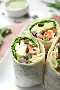 Quick, healthy and filling - these Vegan Mexican Salad Wraps with Creamy Avocado Dressing are a great make ahead lunch, quick dinner or simple snack   ThisSavoryVegan.com #vegan #plantbased #veganrecipe