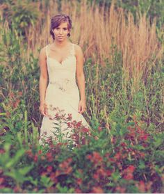 Wildflowers & grasses as a frame, combined with an off-center subject make  for a unique bridal portrait.