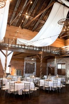 fabric draped barn wedding reception with string lights #wedding #weddingideas #barnwedding
