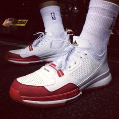 The adidas D Lillard 1 Surfaces in a 'Home' Colorway