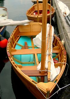 Most beautiful little wooden sailboat I have ever seen.
