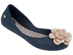 673f2439f A floral embellishment lends an eye-catching touch to these flats