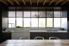 Massive sink anchors, light steel window frames...well...light - Vincent Van Duysen.