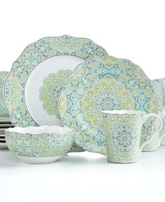 Ornate detailing, wavy edges and a refreshingly cool palette are on display throughout the exquisite Lyria Teal 16-piece Dinnerware Set from 222 Fifth. Featuring an exotic pattern in gleaming porce...