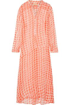 The geometric print on Cloe Cassandro's flowy 'Andrea' dress is inspired by traditional Balinese art. Entirely handcrafted and dyed by local artisans, this loose-fitting maxi style is made from delicate silk-chiffon that's adorned with glowing mother-of-pearl buttons along the front. Swap your swimsuit for a slip to take it into evening.