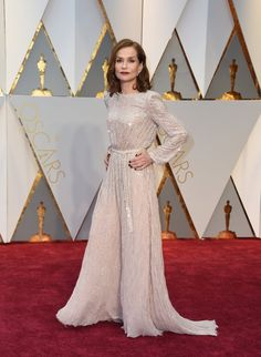 Nominee for Best Actress 'Elle' Isabelle Huppert looks old school Hollywood in this glitzy Armani Privé gown.