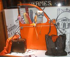 Hermes store window - Notice the backdrop goes only partway but it still is able to set off the product in the display. #millinery #judithm #hats