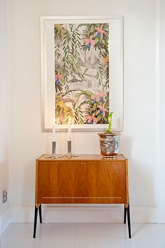 50s/60s bureau, candles, art/painting resembling tropical things