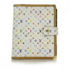 This is an authentic Louis Vuitton Multicolor Large Ring Agenda in White.   It is a stunning Murakami Multicolor canvas design with 33 vibrant colors on white.