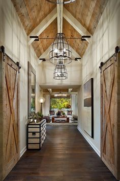Vaulted ceilings, exposed beams and barn doors make this home a farmhouse dream!