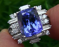 Very unique Tanzanite ring, I am surprised that I like it, but I do! I Love Jewelry, Jewelry Rings, Jewelry Box, Vintage Jewelry, Fine Jewelry, Tanzanite Jewelry, Tanzanite Ring, Gemstone Jewelry, Schmuck Design
